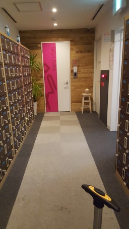 After 1st door, common area with the shoes-lockers. At the end the 'ladies' floor door.